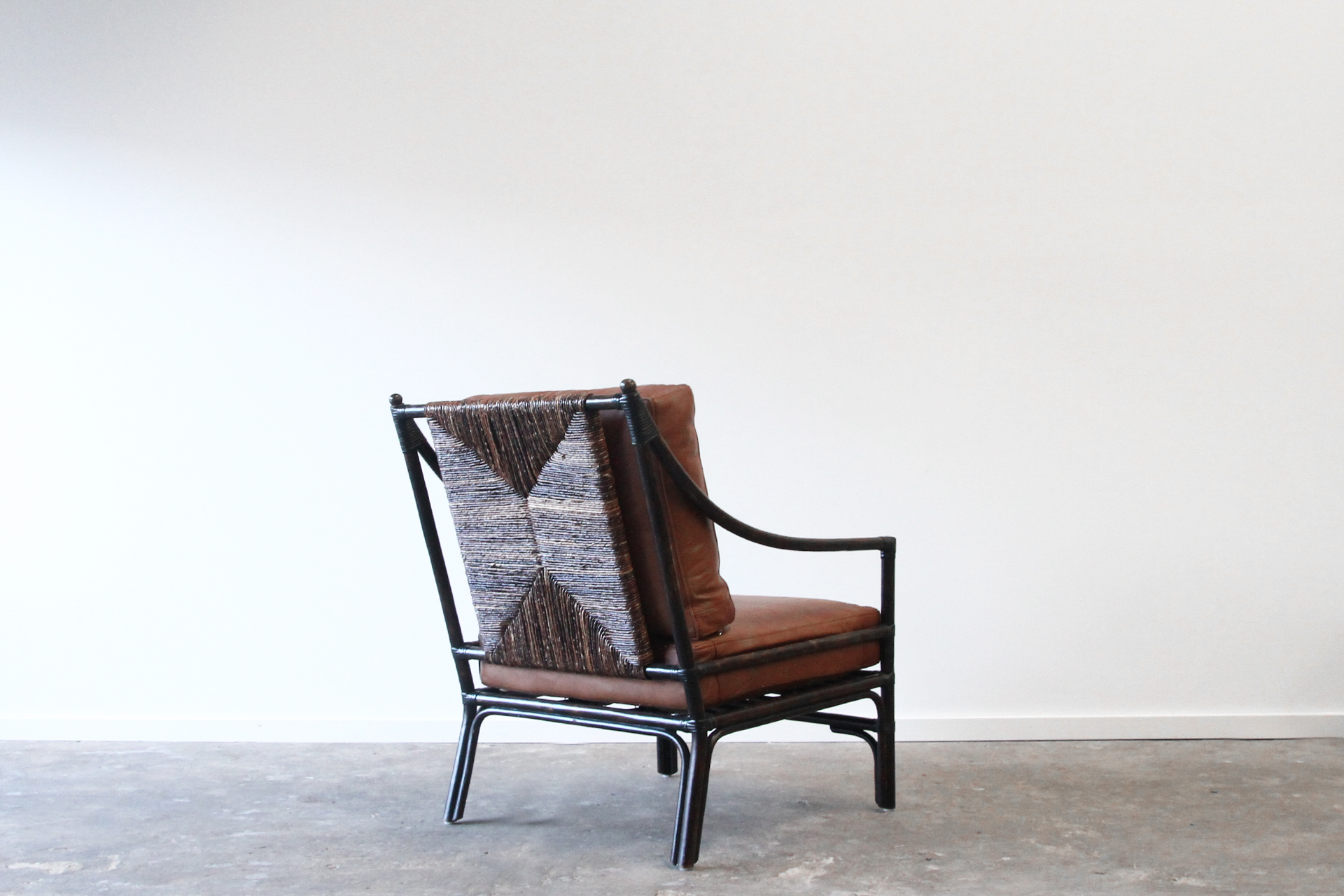 Rattan armchair with abaca weave