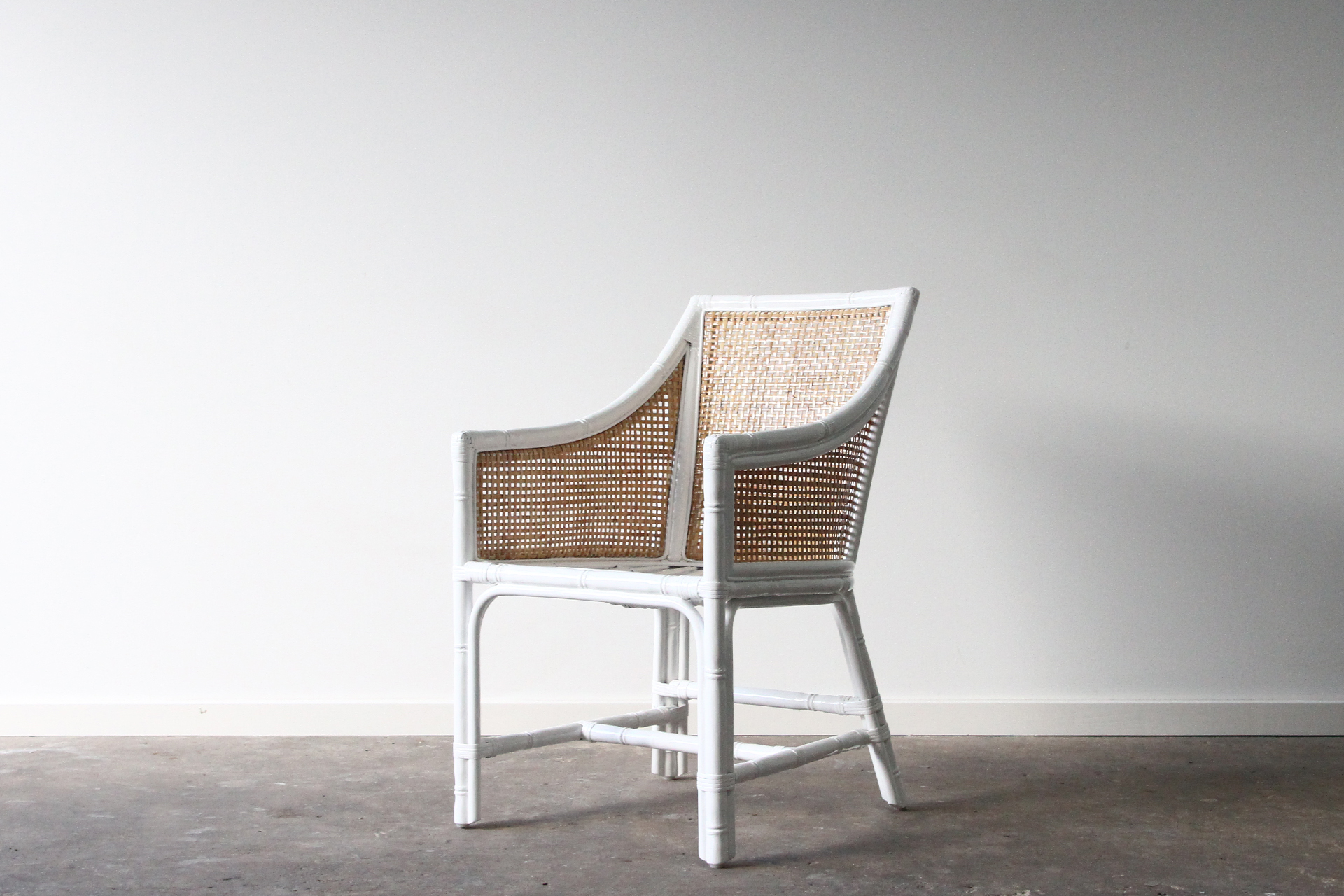 Carved rattan dining chair