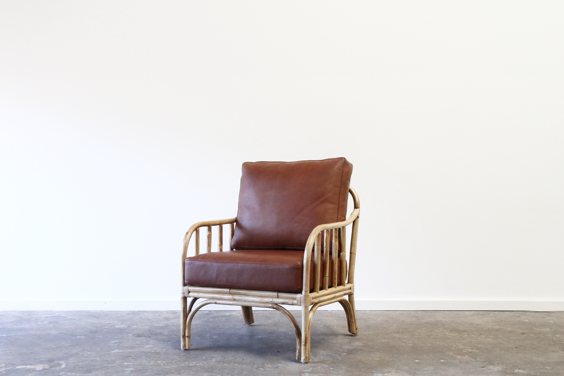 Rattan armchair with leather