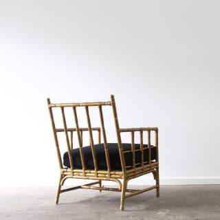 Gold rattan armchair