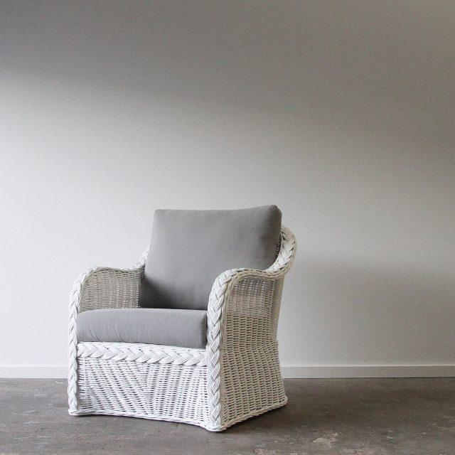 White wicker cane armchair