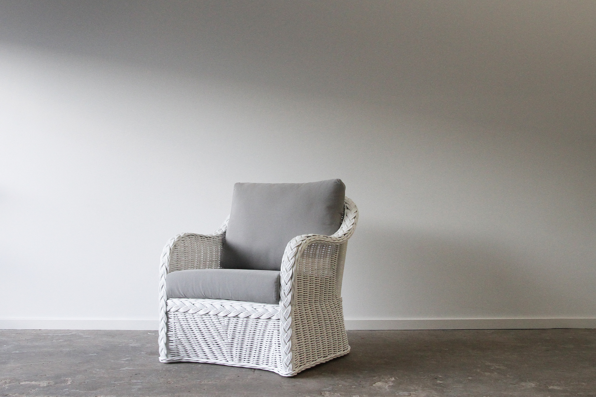 White wicker cane armchair