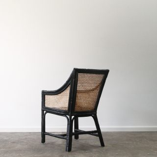 Carved cane dining chair