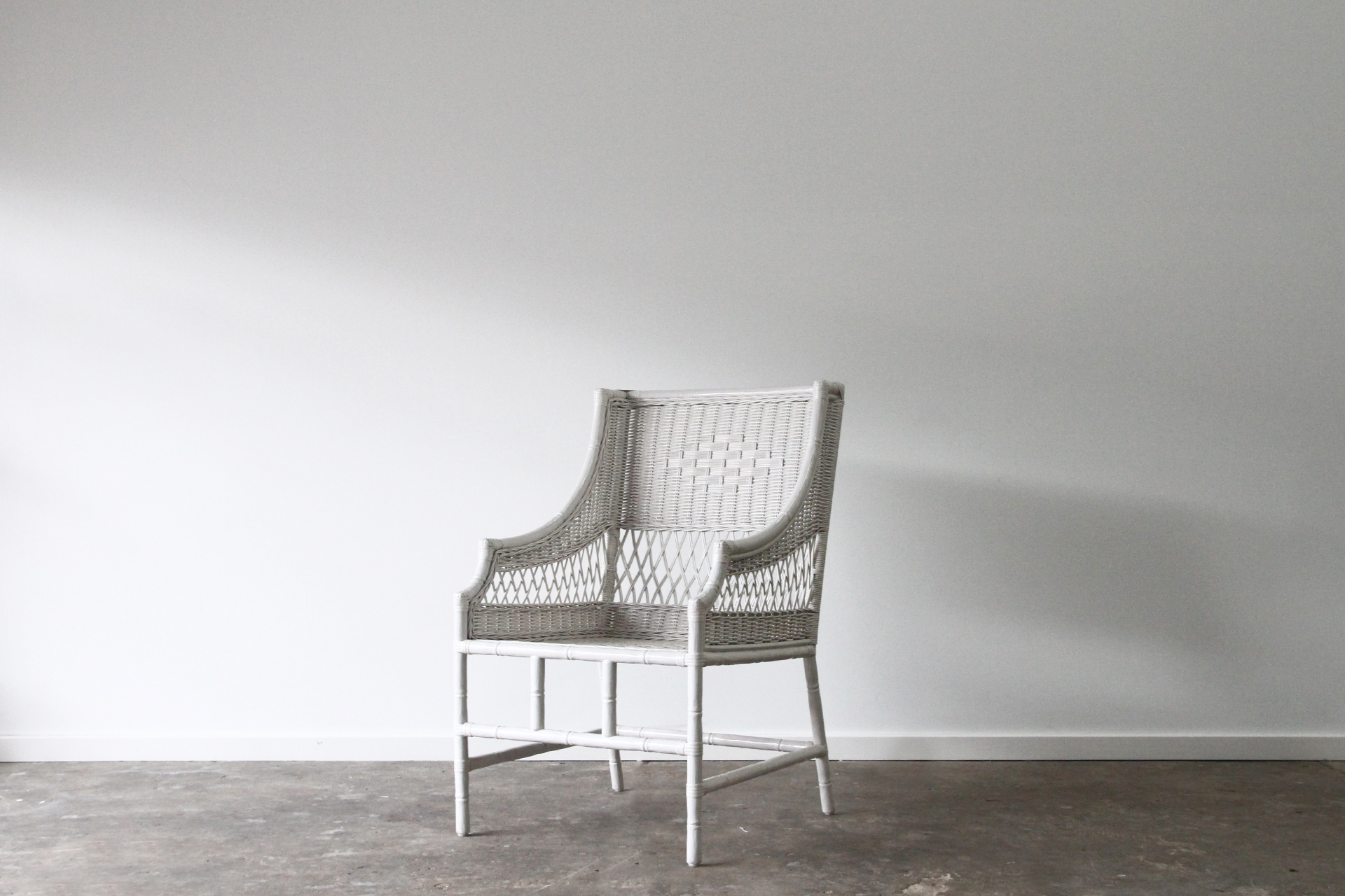Carved Rattan dining chair in white wash cane
