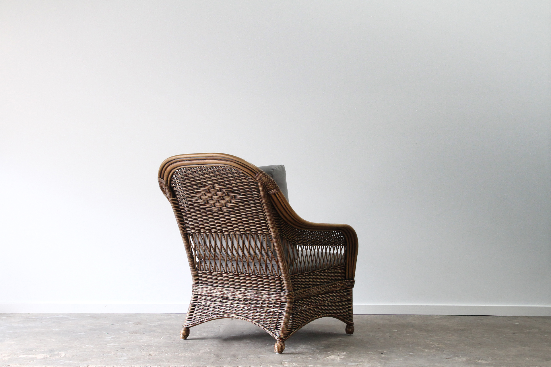 Wicker high back cane armchair