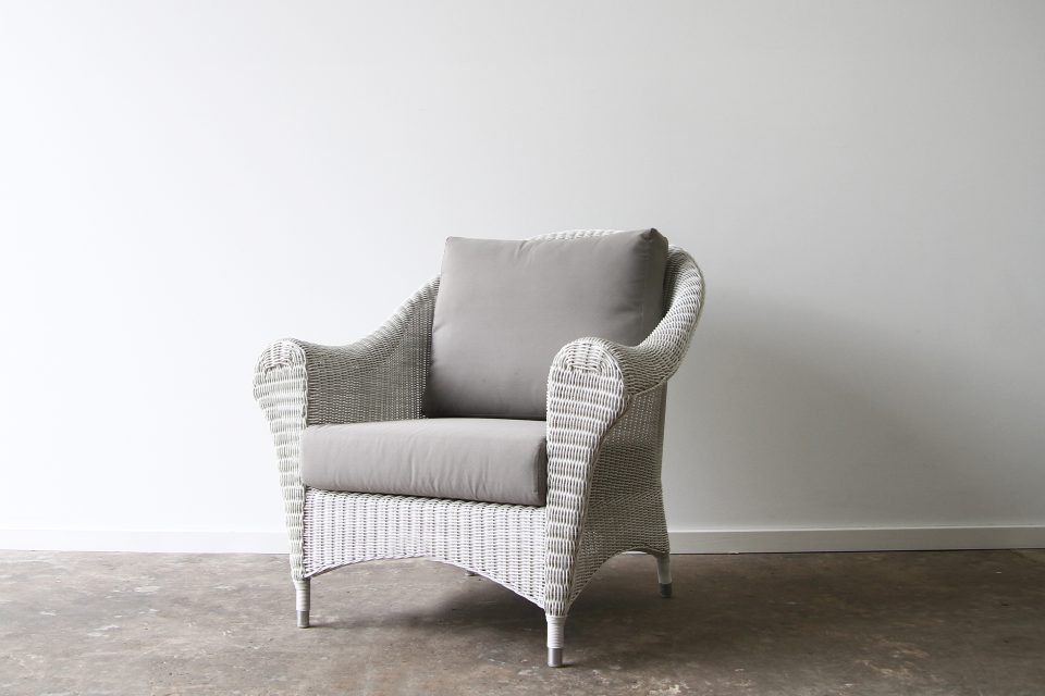 White washed wicker armchair