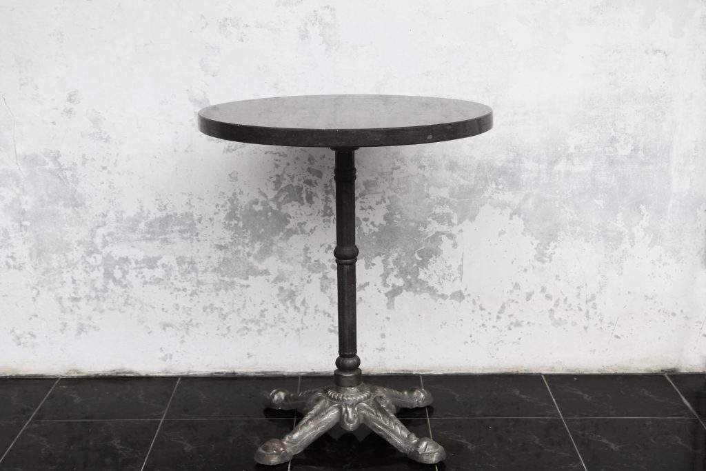 Cast iron base with stone top